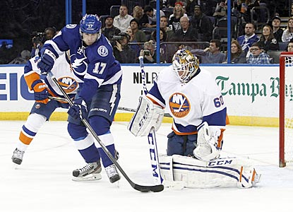 Islanders goaltender Kevin Poulin turns away Tampa Bay's Alex Killorn during the second period.  (USATSI)