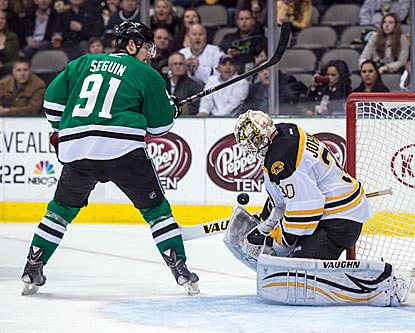 Chad Johnson -- no, not THAT Chad Johnson -- makes a save on Dallas center Tyler Seguin during the second period.  (USATSI)