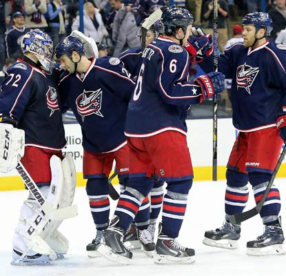 Goalie Sergei Bobrovsky and the Blue Jackets celebrate a win over their Capitals, their fifth consecutive victory.  (USATSI)