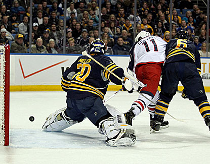 Matt Calvert deflects the puck past Sabres goalie Ryan Miller in the Blue Jackets' 4-3 win over Buffalo. (USATSI)