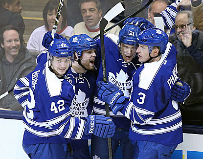 James van Riemsdyk celebrates with his Toronto teammates after scoring the game-winner against the Canadiens. (USATSI)