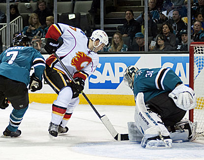 Sharks goalie Antti Niemi stops Calgary's Lance Bouma for one of his 21 saves in the San Jose victory. (USATSI)
