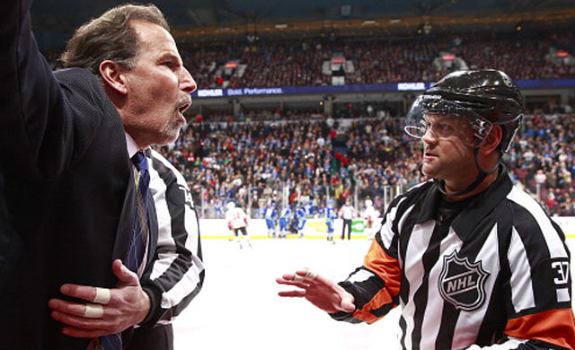 John Tortorella lets the Calgary bench and opposing coach Bob Hartley know how he feels. (Getty Images)