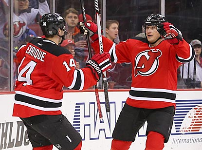 Adam Henrique (left) celebrates with Michael Ryder after scoring to push New Jersey's lead to 5-1.  (USATSI)