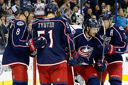 Artem Anisimov (second from right) celebrates with teammates after his goal increases the Blue Jackets' lead to 5-2.  (USATSI)