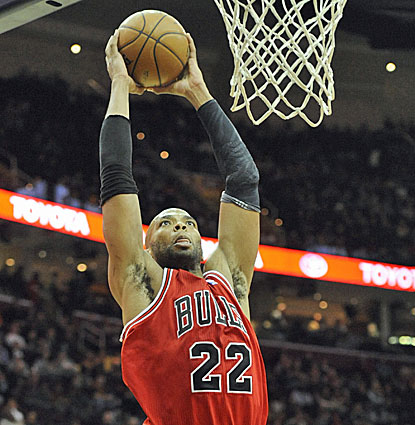 Chicago forward Taj Gibson gets up for the dunk, two of his career-high 26 points against the Cavaliers. (USATSI)