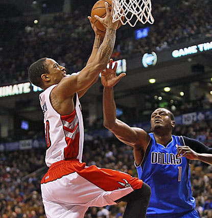 Toronto's Demar DeRozan goes strong to the hoop against the Mavericks. DeRozan scores a career-best 40 points.  (USATSI)