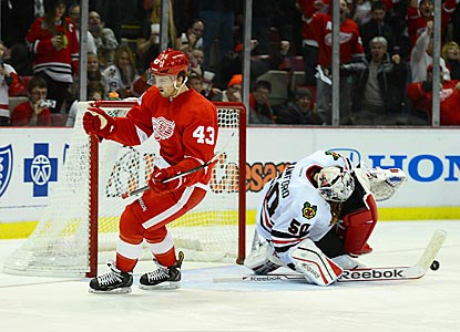 Darren Helm reacts after scoring what proves to be the winning shootout goal against Chicago's Corey Crawford.  (USATSI)
