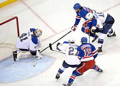 St. Louis goaltender Jaroslav Halak makes a stop on New York star forward Rick Nash during the third period.  (USATSI)