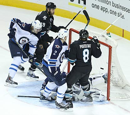 Joe Pavelski (8) sees his shot get past Winnipeg goaltender Ondrej Pavelec in the third period.  (USATSI)