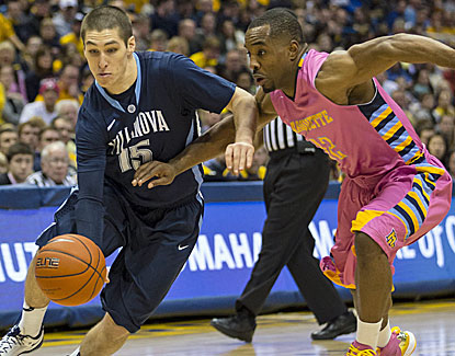 Villanova's Ryan Arcidiacono scores 20 points to go with 11 assists, including six points and two assists in overtime. (USATSI)