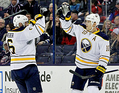 Buffalo's Christian Ehrhoff, right, notches a first-period goal as the Sabres snap a five-game losing streak. (USATSI)