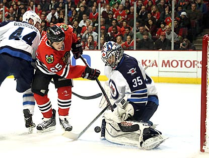 Goaltender Al Montoya excels in a spot start for Winnipeg. This first-period denial of Andrew Shaw is among his 34 saves.  (USATSI)