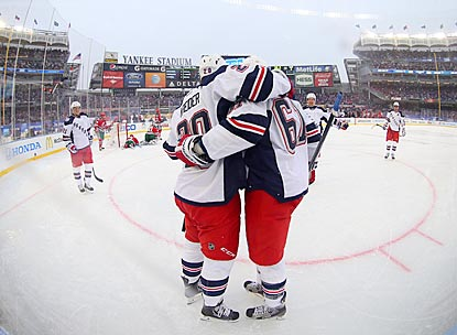 On a snowy day at Yankee Stadium, Chris Kreider is the first to congratulate Rick Nash on his goal in the second period.  (USATSI)