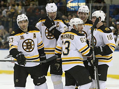 The line of Patrice Bergeron (left), Brad Marchand (63) and Reilly Smith (18) registers nine points for Boston.  (USATSI)