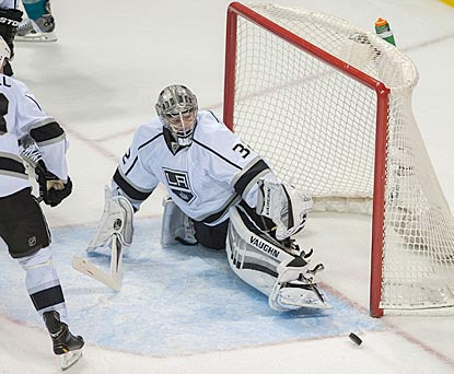 Jonathan Quick makes a save in the final moments of the game to preserve his shutout and end LA's five-game losing streak.  (USATSI)