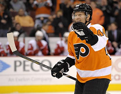 Flyers defenseman Kimmo Timonen celebrates Philly's first goal, which starts a rout of the overmatched Red Wings.  (USATSI)