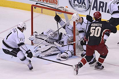 There's two Kings players in the net, but Antoine Vermette finds room to give Phoenix an insurance goal in the third period.  (USATSI)
