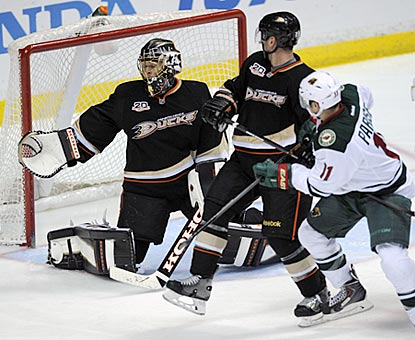 Zach Parise watches his shot get past Anaheim's Jonas Hiller, which pushes Minnesota's lead to 3-1 early in the third period.  (USATSI)