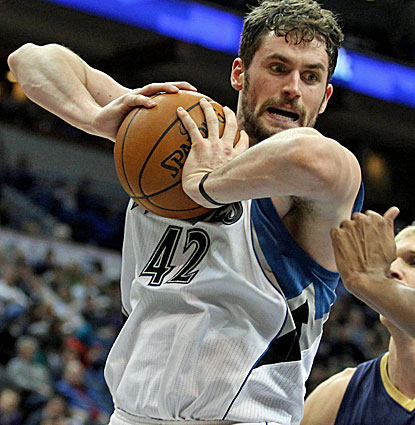 Minnesota power forward Kevin Love grabs one of his 14 rounds against the Pelicans. He also scores 30 points. (USATSI)