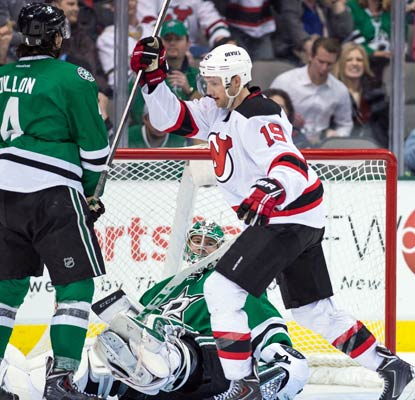 Travis Zajac celebrates Patrik Elias' (not pictured) overtime goal against the Stars in the Devils' 3-2 victory.  (USATSI)