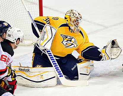 Carter Hutton gives up two second-period goals but Nashville rallies to beat New Jersey in OT. (USATSI)