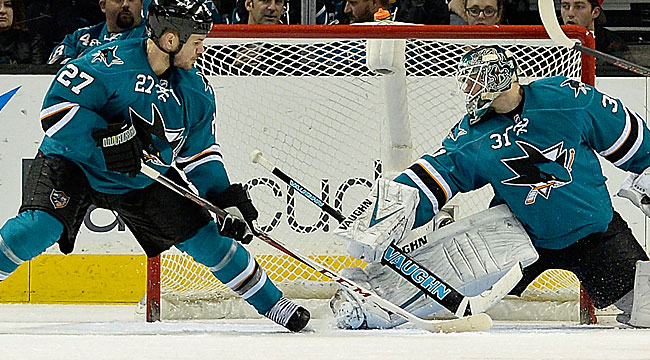 Joe Thornton helps San Jose end its three-game losing streak with a nifty move in the shootout against Corey Crawford. (Getty Images)