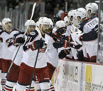 Nick Foligno goes down the Blue Jackets welcoming line after notching one of the two goals he scores during the third period.  (USATSI)