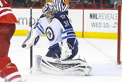 Jets goaltender Ondrej Pavelec makes a save on one of a dozen Hurricanes shots he stops in the second period.  (USATSI)