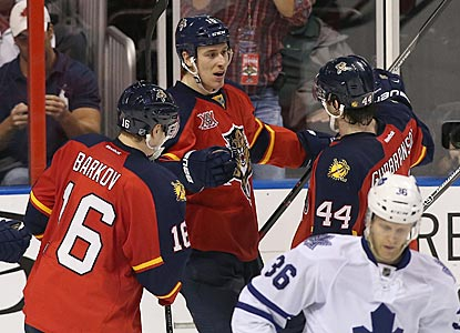 Shawn Matthias (center) is greeted by teammates Aleksander Barkov (left) and Erik Gudbranson after scoring in the third period. (USATSI)