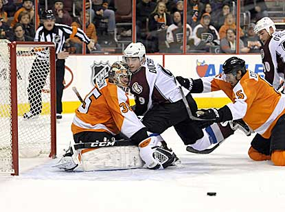 Steve Mason stands up well against Colorado for almost the entire game, even when Matt Duchene falls into him.  (USATSI)
