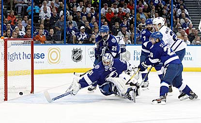 James van Riemsdyk (right), along with three Lightning defenders plus goalie Cedrick Desjardins, watches his third-period goal. (USATSI)