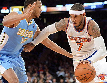 Carmelo Anthony scores 31 points in just 33 minutes against the Nuggets, giving the Knicks a needed lift. (USATSI)