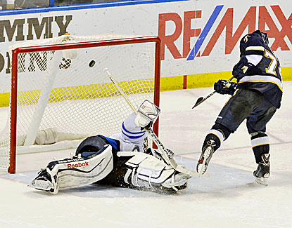 St. Louis' T.J. Oshie gets the puck past Al Montoya during the shootout, helping to seal the win for the Blues. (USATSI)