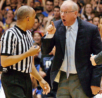 Syracuse coach Jim Boeheim has some words for the ref after a charge call late in the game. Boeheim is ejected.  (USATSI)