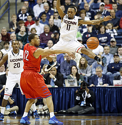 Nick Russell moves the ball for SMU around UConn's Ryan Boatright. Russell scores 15 points to go with four assists. (USATSI)
