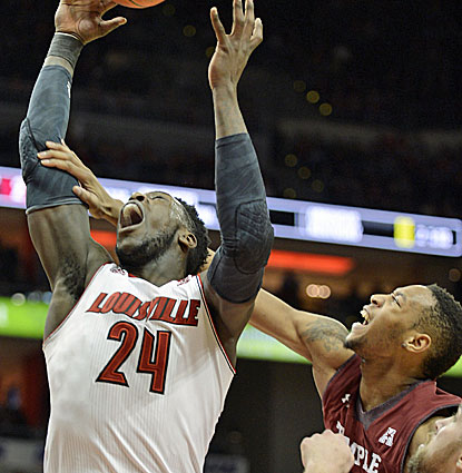 Louisville forward Montrezl Harrell gets hit on the way to the hoop. Harrell scores 21 points and grabs six rebounds. (USATSI)