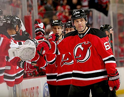 Jaromir Jagr goes down the reception line after scoring in the first period. He's one shy of 700 in his NHL career.  (Getty Images)