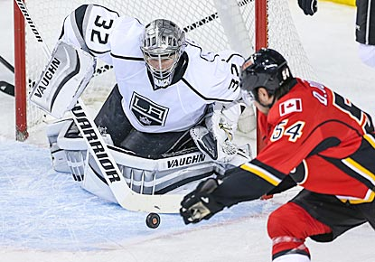 Jonathan Quick denies Calgary's David Jones in the second period, during which he makes 15 of his 25 saves.  (USATSI)