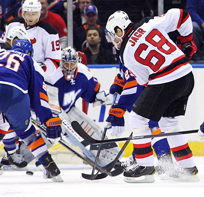Jaromir Jagr slips through the Islanders' defense in the second period to score his 700th career NHL goal.  (USATSI)