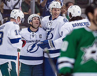 Tampa Bay captain Martin St. Louis scores a pair of goals to lead the Lightning to a win over Dallas. (USATSI)