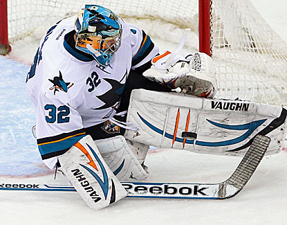 San Jose goalie Alex Stalock makes the stop against New Jersey, one of his 21 saves in the game. (USATSI)