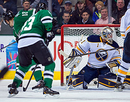 Alex Chiasson (12) redirects the winning goal past Sabres goalie Jhonas Enroth during the third period. (USATSI)