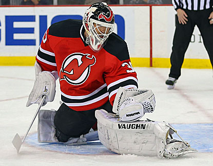 Martin Brodeur makes 20 saves to beat Detroit in what could be his last game with the New Jersey Devils. (USATSI)