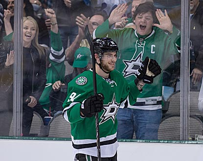Stars fans celebrate after Tyler Seguin completes his third hat trick of the season, which ties a team record.  (USATSI)