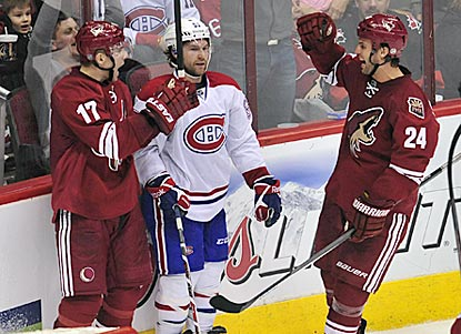 Radim Vrbata (right) celebrates his second goal with teammate Kyle Chipchura during the third period.  (USATSI)