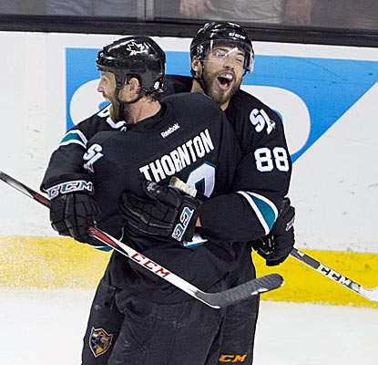 Joe Thornton and Brent Burns combine to score the final three goals of San Jose's latest home victory against Pittsburgh.  (USATSI)