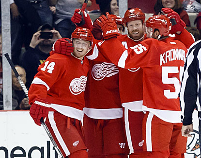The Red Wings do plenty of celebrating in front of the New Jersey net in a 7-4 victory. (USATSI)