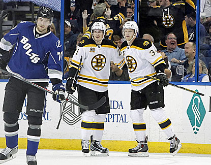 Carl Soderberg, right, scores a goal with an assist for the Bruins, who edge Tampa Bay in a shootout. (USATSI)
