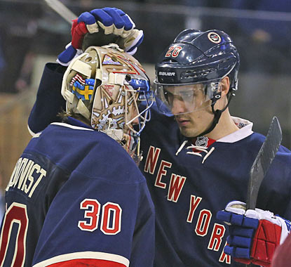 Two-goal scorer Chris Kreider and Henrik Lundqvist share a moment after a solid Rangers win Sunday.  (USATSI)